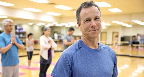 Older man in yoga class